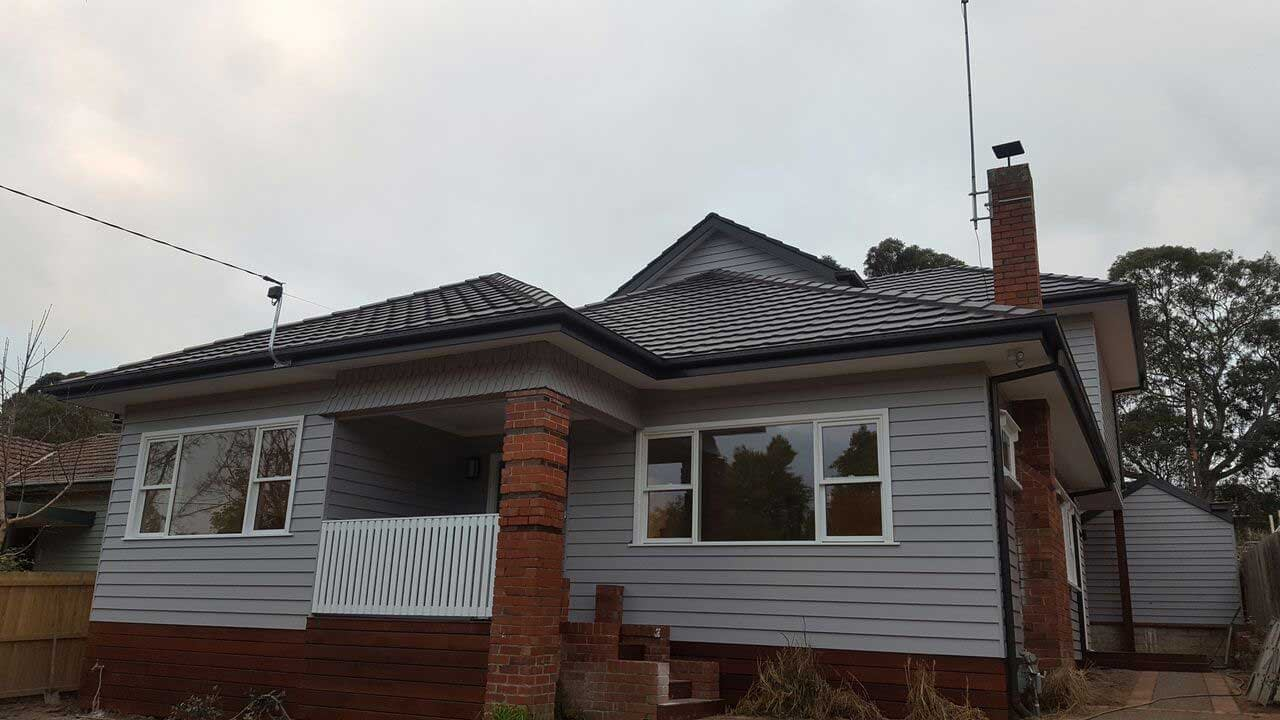 Classic home renovation in Camberwell. View from driveway, by Mass Constructions.