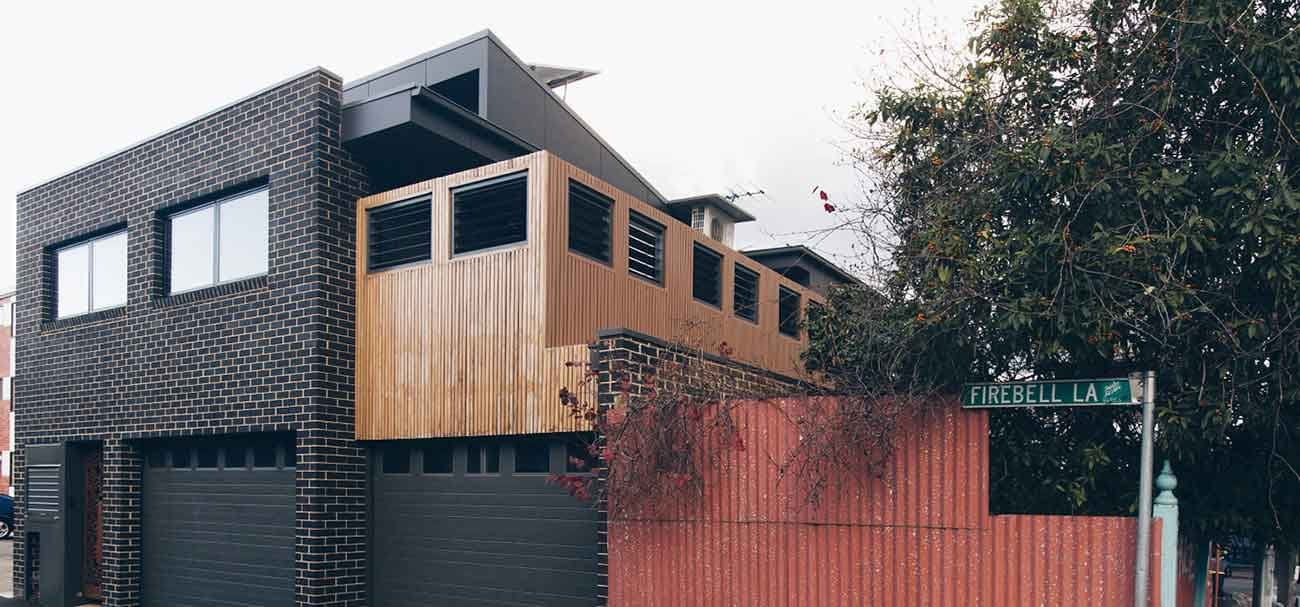 Richmond second storey extension by Mass Constructions. Brick and timber construction.